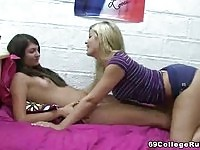Blonde and brunette girls get off in their dorm
