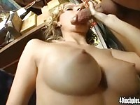Busty blonde in garage fuck