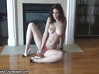 Carlotta Champagne stripping in a photoshoot