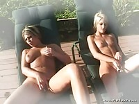 Courtney Simpson and Solana in pool side fingering
