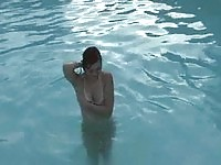 Skinny young teen in the pool