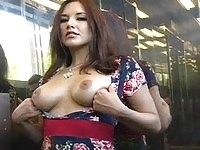 Large tit Zoe flashes her pussy