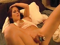 Tasty brunette working her wet pussy