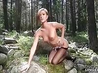 Stunning babe Natalia naked at the forest