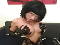 Busty leather girl fingering