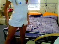 Naughty nurse puts on a webcam show