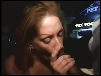 Mature redhead brit blowing a guy in public