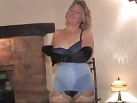 Mature lady strips down teases