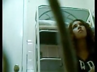 Amateur brunette taking a pee