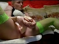 A housewife masturbating over porn