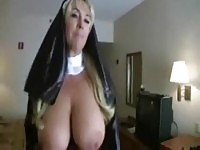 Dressed up wife shows off her tits
