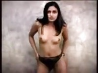 Black haired Indian girl strips down