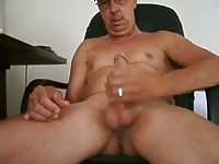 Old guy masturbating over porn