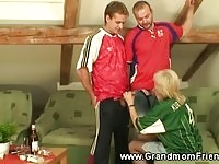 Blonde granny sucking football fans!