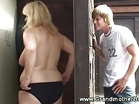 Young voyeur watching a busty granny shower