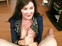 Attractive MILF jerking off a stiff cock