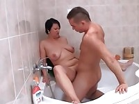 Mature and teen in bath action