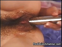 Asian hottie toying her lactating hairy pussy