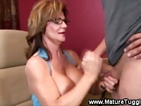 Busty granny gets fresh cum on her boobs
