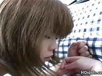Pretty Japanese teen gets shaved snatch fingered