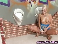 A nasty blonde in slime action