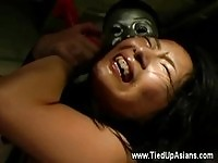 A tied up asian in bdsm
