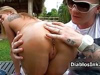 A nasty pierced blonde sucking in the backyard