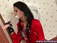Rich brunette getting slime