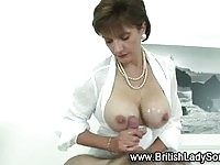 A busty mature in tit fuck