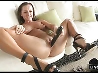 Sexy brunette with black dildo