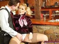 A sexy blonde gets licked in some bar