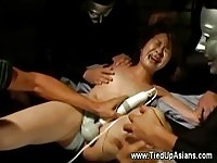 Pretty molested Asian teen banged by multiple sex toys
