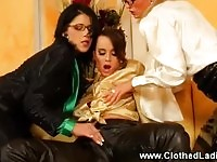 Attractive clothed babes pampering one another