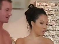 Stunning masseuse stroking her clients rod