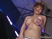 Sweet Asian beauty pounding her ass with sex toy