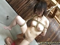 Tied asian babe pussy stuffed with weird objects