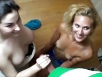 Horny babes share a hard cock to wank