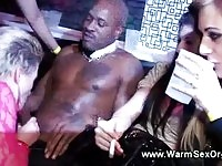 Drunk girls giving blowjob in front of the partying crowd