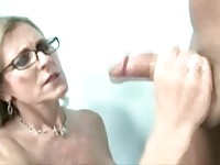 Cock craving cougar mom tugging a young stud