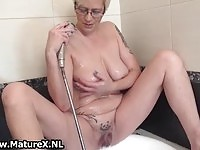 A busty mature lady masturbating