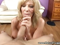 Milf strokes and swallows a boys cock