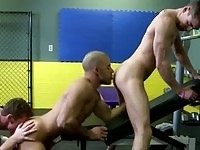 Sexy gay studs in gym action