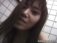 Asian babe sucking cock in public toilet