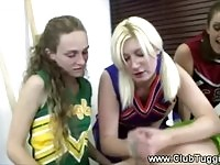 Cheerleaders in uniform give a handjob