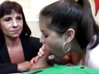 Mom and daughter sucking on the same cock