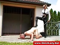Blonde mistress taking care of her slave