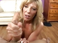 Hot blonde milf tugging and sucking cock for this guy
