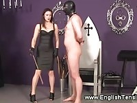 Domina puts her hooded subs balls on a leash