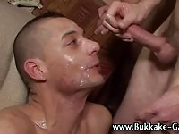 Punk dude gets his face covered in cum