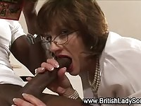 Busty cougar mom sucking a monster black cock